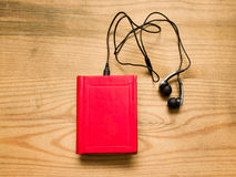 Headphones and a book Stock Photo