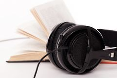 Headphones and book on a white background Royalty Free Stock Images