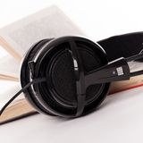 Headphones and book on a white background Stock Photography