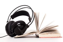 Headphones and book on a white background Royalty Free Stock Photography