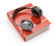 Headphones and book Royalty Free Stock Image