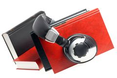 Headphones and books Royalty Free Stock Image