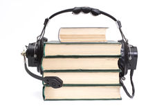 Headphones and books. Audiobook conception with headphones and books Stock Photo