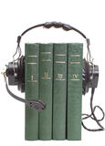 Headphones and books. Audiobook conception with headphones and books Stock Photography