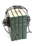 Headphones and books. Audiobook conception with headphones and books Stock Image