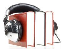 Headphones and books stock photos