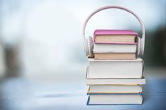Headphones on Books Stock Image