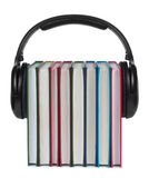 Headphones on books on white background. Stock Image