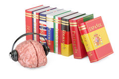 Headphones with brain and books, languages learning. And translate concept Royalty Free Stock Image