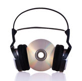 Headphones on a cd. Headphones with cd isolated on white background Stock Images