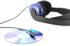 Headphones with cd. And shiny jackplug isolated on white Stock Photography
