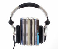 Headphones with CD boxes. On white background Royalty Free Stock Images