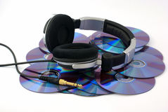 Headphones on CD disks. On white background Royalty Free Stock Image