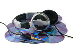 Headphones on CD disks. On white background Royalty Free Stock Photos