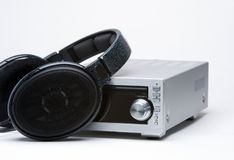 Headphones and cd player. A pair of headphones resting against a cd player Stock Images
