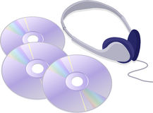 Headphones and CDs. Three CDs and a pair of headphones, arranged together Stock Photography