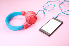 Headphones with cellphone Royalty Free Stock Photo