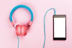 Headphones with cellphone Stock Photo
