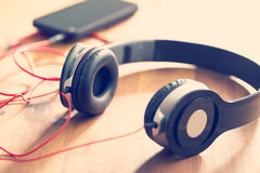Headphones with cellphone Royalty Free Stock Photography