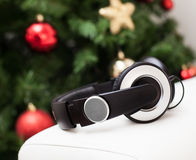Headphones with christmas tree. Royalty Free Stock Photos
