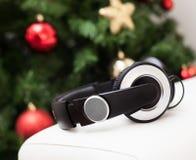 Headphones with christmas tree. Royalty Free Stock Photos