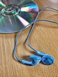 Headphones. Close view of headphones and cd Royalty Free Stock Images