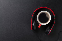 Headphones and coffee cup Royalty Free Stock Image