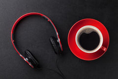 Headphones and coffee cup Royalty Free Stock Images