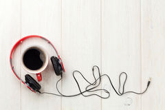 Headphones and coffee cup Stock Photo