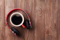 Headphones and coffee cup Stock Photos