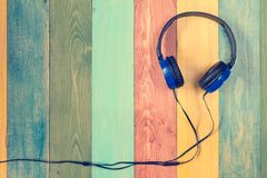 Headphones on colored wooden background Royalty Free Stock Image