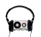 Headphones on Compact Cassette. HIfi headphones on vintage Compact Cassette on white background Stock Photos