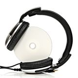 Headphones with compact disc. On white background Stock Photos