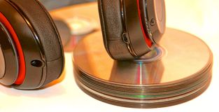 Headphones and Compact Music Disc Royalty Free Stock Images