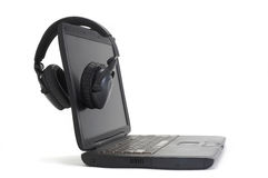 Headphones On Computer Royalty Free Stock Photos