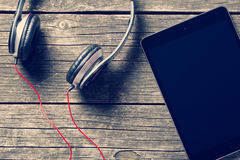 Headphones and computer tablet royalty free stock photography