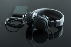 Headphones connected to the cellphone. Royalty Free Stock Images