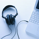 Headphones Connected to Laptop Royalty Free Stock Photos