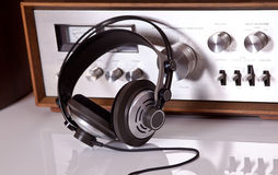 Headphones connected to vintage audio stereo. Headphones connected to audio stereo devices closeup stock photo
