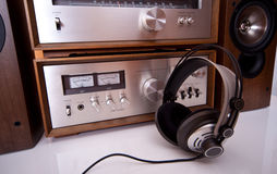 Headphones connected to vintage audio stereo. Headphones connected to audio stereo devices closeup stock images