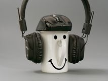 Headphones cup and mouse. stylized music lover on a gray background. 5 royalty free stock photos