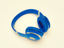 Headphones. 3D render illustration of blue earphones on a white background Royalty Free Stock Photos