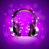 Headphones on dark glowing background vector Stock Photography