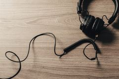 Headphones on dark wooden background stock images