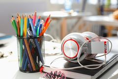 Headphones diary and pencil lie on the desk of the concept Stock Image