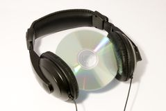 Headphones and a disc. Concept of music - headphones with a CD discs in-between Stock Photo