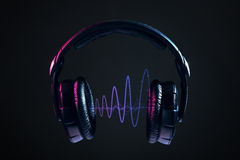 Headphones and disco waves isolated on black background Stock Photography