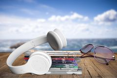 Headphones and compact discs on wooden table. Headphones discs personal accessory audio equipment head phones head phones isolated head phones isolation Stock Photos