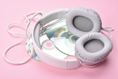 Headphones with Discs. On a pink Background Royalty Free Stock Photo