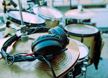 Headphones and drum. Close-up image of drum and headphones royalty free stock photography